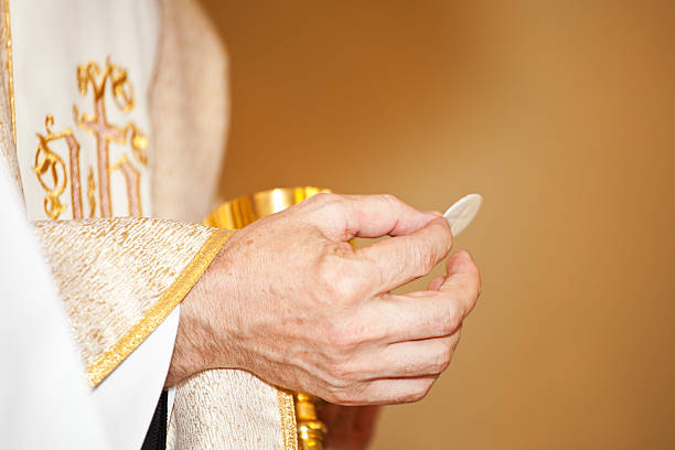 communion and clergyman - communion stock photos and pictures