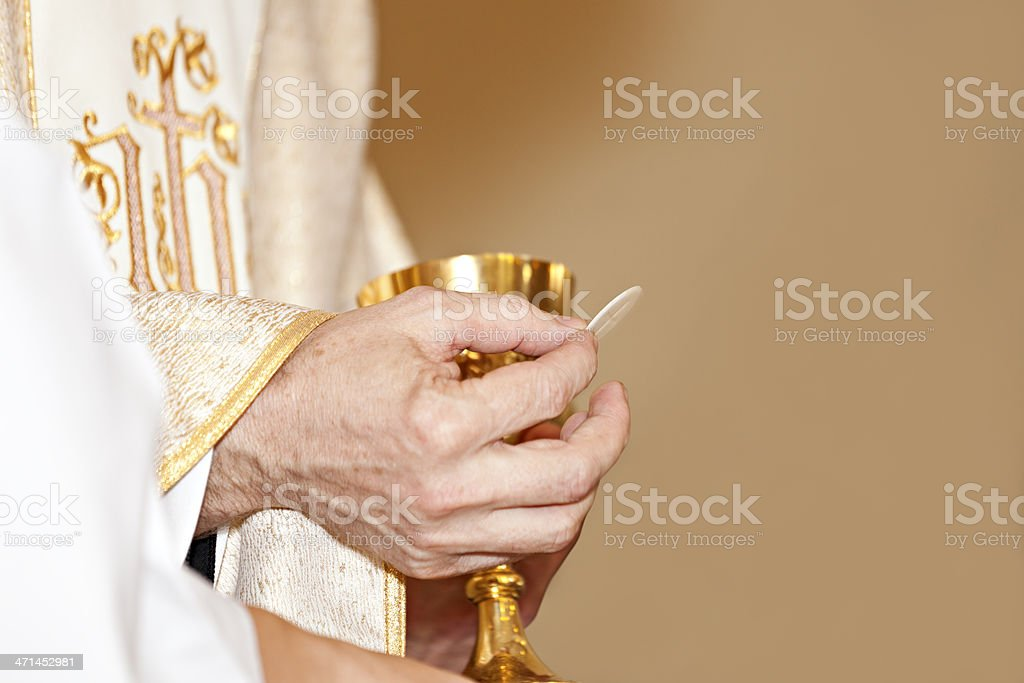 Communion and clergyman stock photo