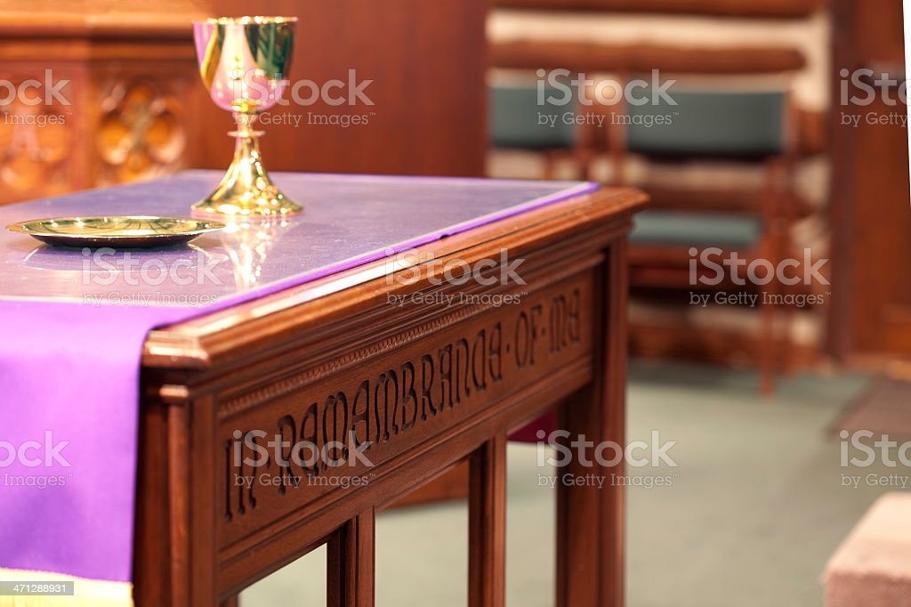 Communion Chalice and Tray on Altar Table in Church stock photo