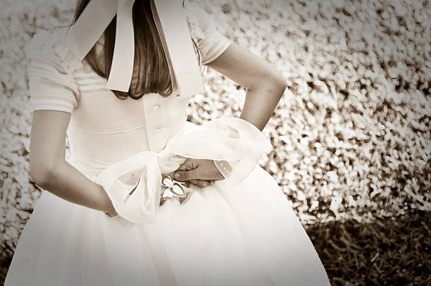 communion dress and a silver angel - communion stock photos and pictures