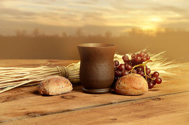 communion elements at sunset - communion stock photos and pictures