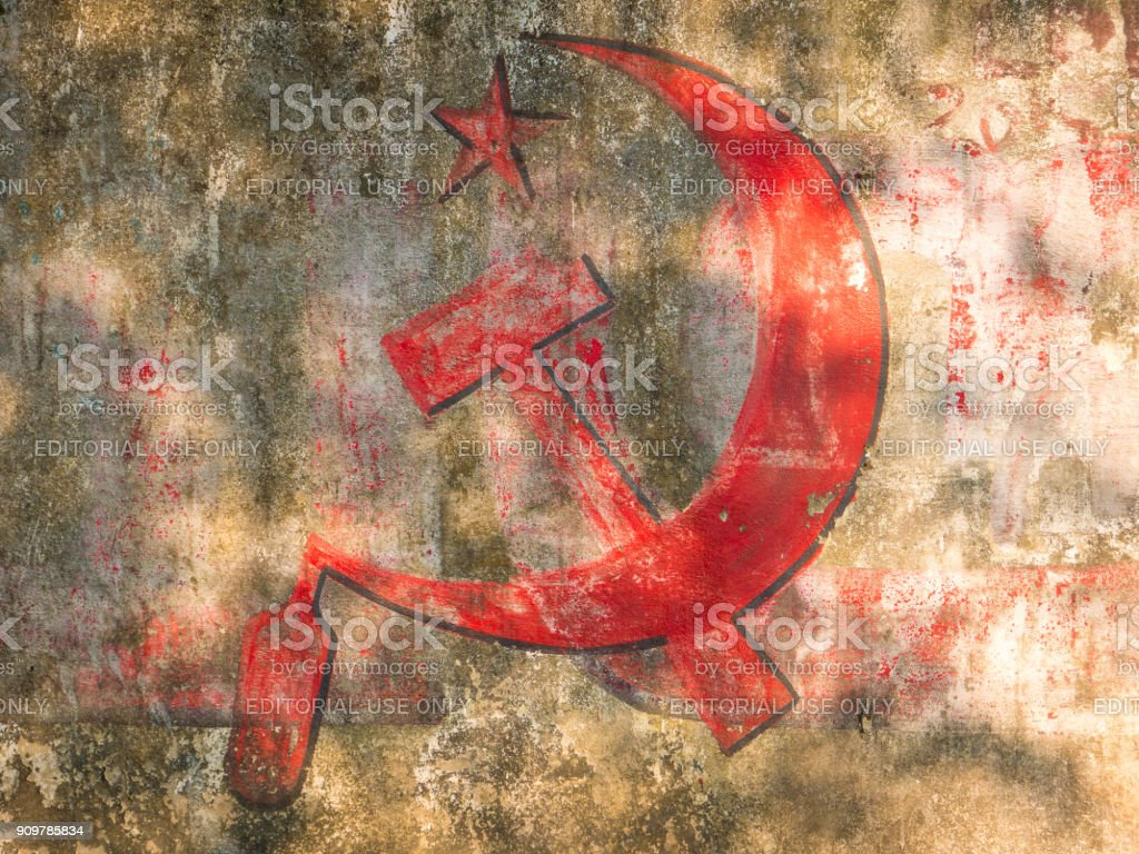 Communist party tag on a wall in India stock photo