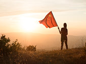 Communist with Chinese flag on top of a mountain