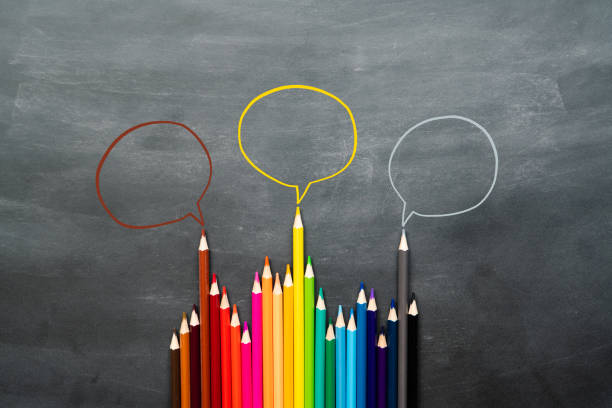 Community communication, represents people conference, social media interaction & engagement. group of pencils sharing idea on the black background with copy space stock photo