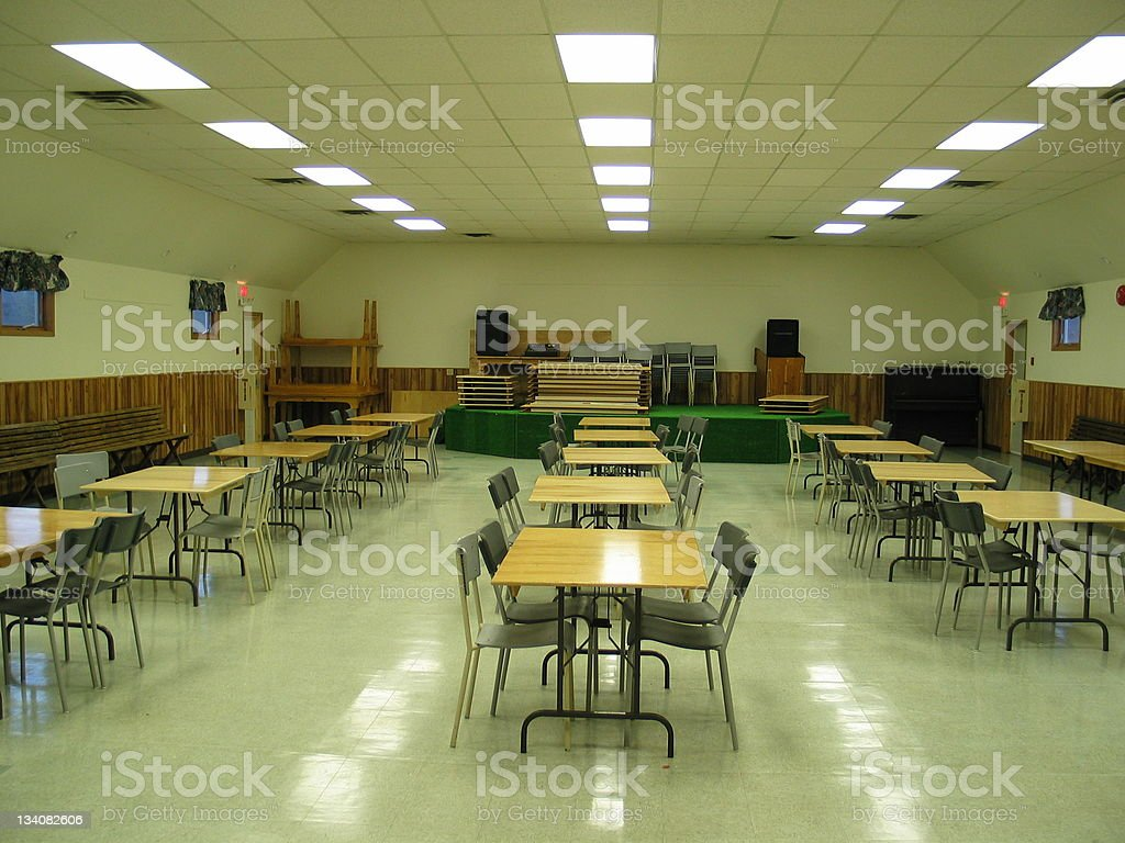 Community hall with tables and chairs stock photo