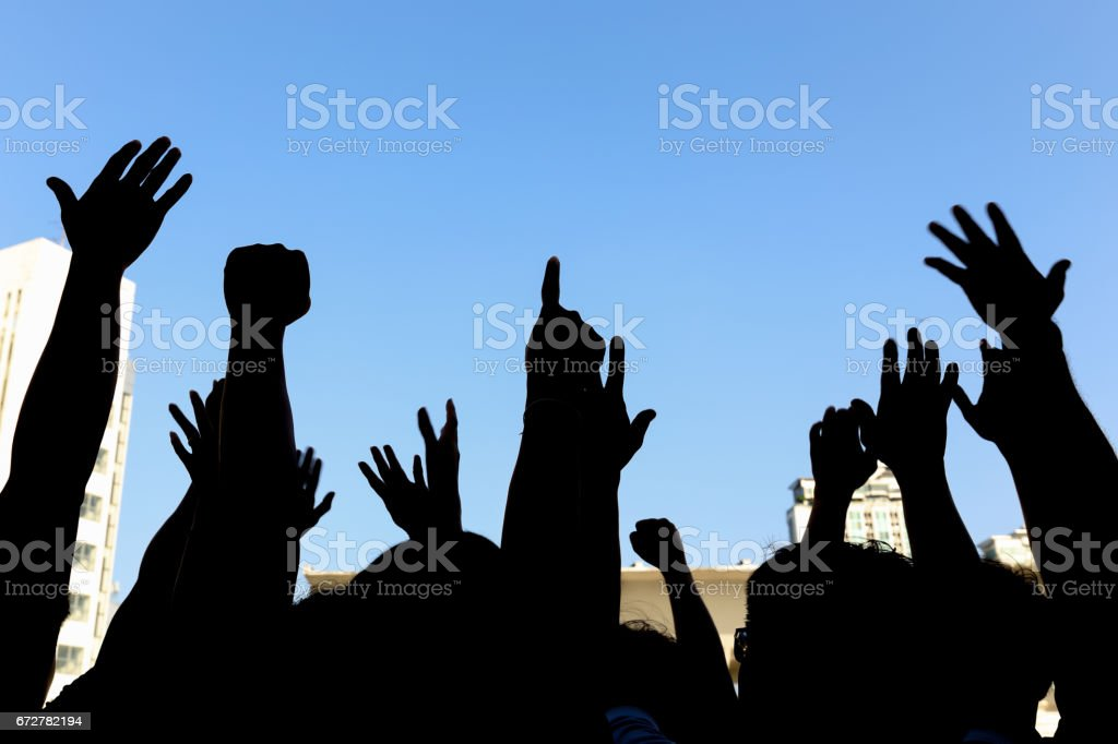 community initiative or concert concept, hands of group of people in the sky, silhouette stock photo