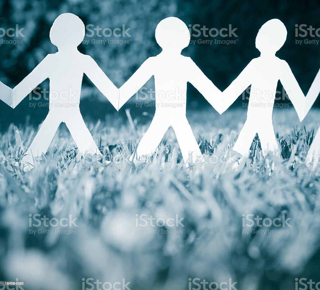 Community linked silhouette isolated on white - Paper doll royalty-free stock photo