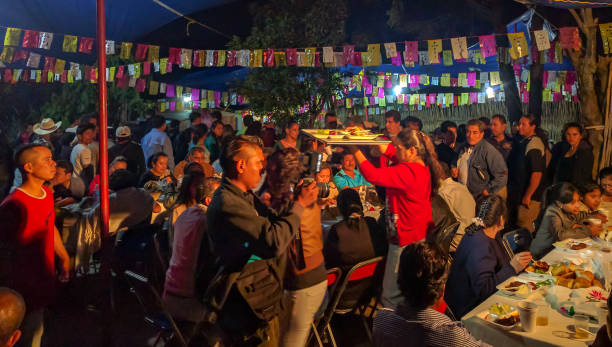 Community meal at the Calenda San Pedro in Oaxaca, Mexico. SAN PEDRO APOSTAL, OAXACA-July 2, 2016. A host family serves a meal to the hundreds of local residents to celebrate the Calenda San Pedro, an annual regional calendar event that honors St Peter the Apostle. mexican culture stock pictures, royalty-free photos & images