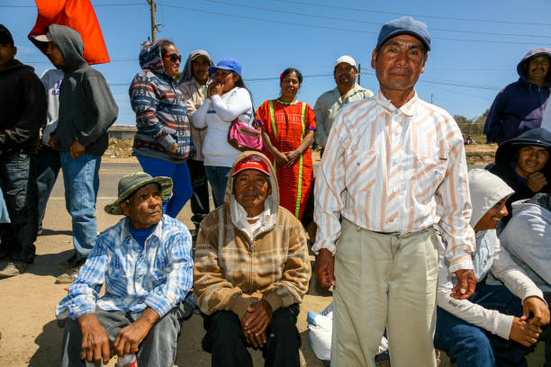 A community meeting of seasonal an daily farm workers in Baja California Mexico San Quintin, Baja California, Mexico, May 25 - Some persons in a community meeting in a poor area where seasonal farm workers live, commonly employed in the cultivation of strawberries, melons and fruit, in San Quintin, in the Mexican state of Baja California, 200 km south from the border between Mexico and the United States. migratory workers stock pictures, royalty-free photos & images