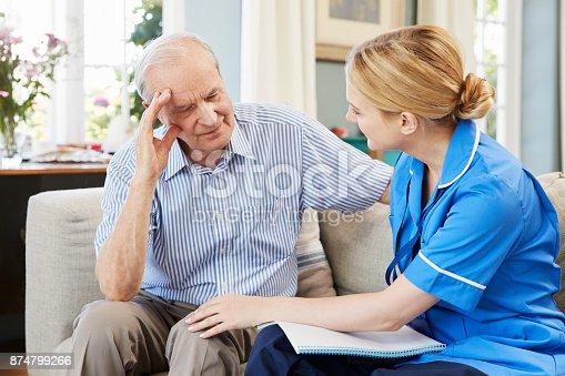 istock Community Nurse Visits Senior Man Suffering With Depression 874799266