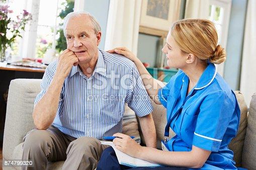 istock Community Nurse Visits Senior Man Suffering With Depression 874799320