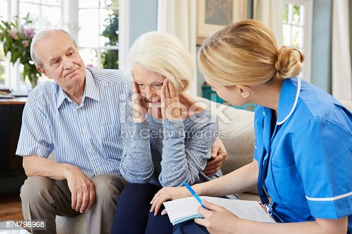 874789476istockphoto Community Nurse Visits Senior Woman Suffering With Depression 874796968