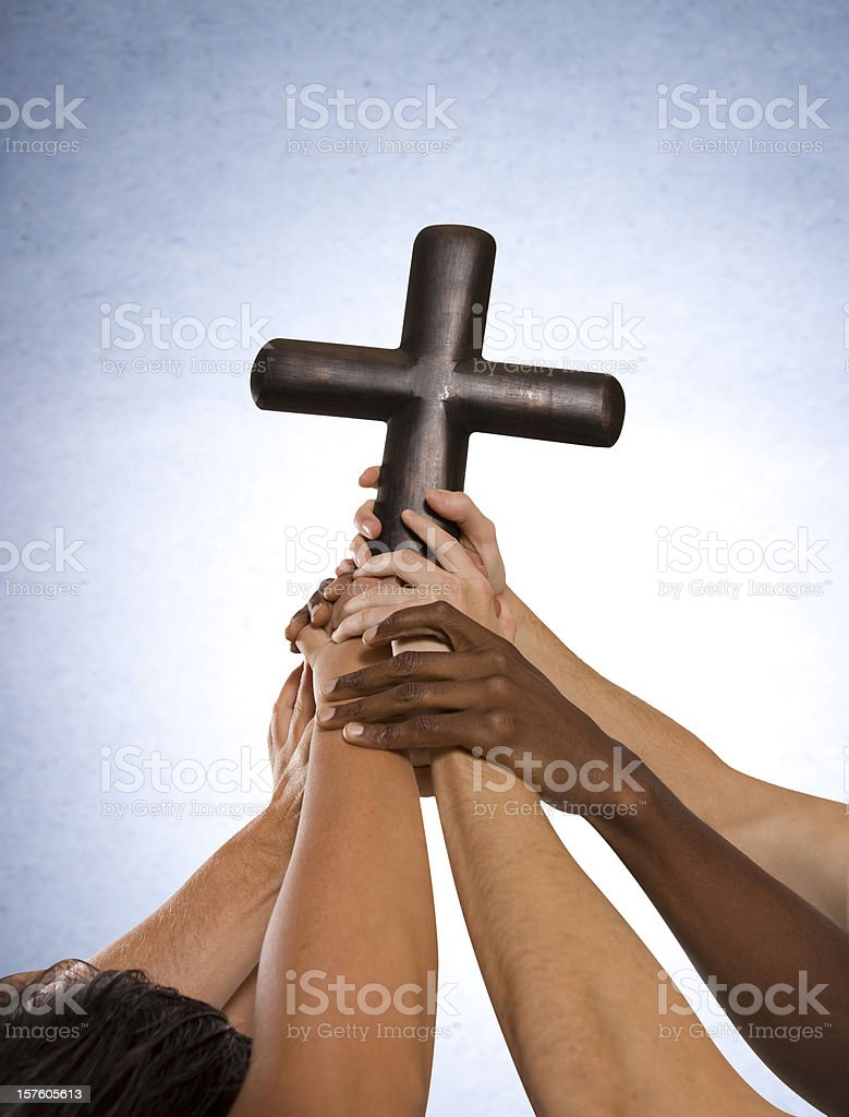 Community of Hands holding cross together stock photo