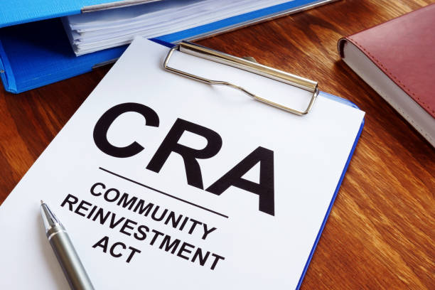 Community Reinvestment Act CRA in the blue clipboard. stock photo