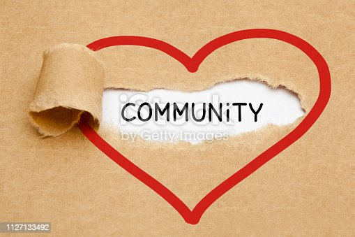 istock Community Ripped Heart Paper Concept 1127133492
