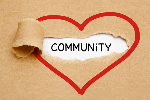 community ripped heart paper concept - единство стоковые фото и изображения
