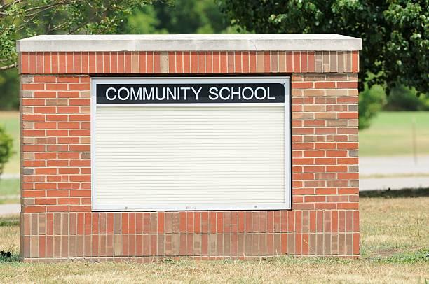 Community school marquee sign stock photo