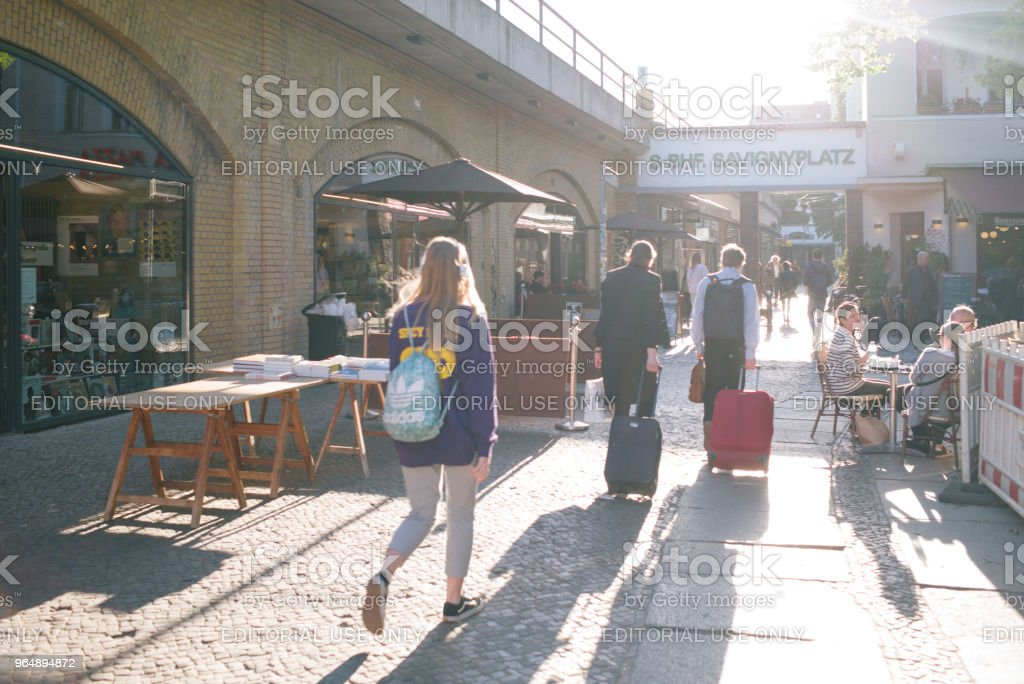 commuter and tourists walk to the subway station 'Savignyplatz'. royalty-free stock photo