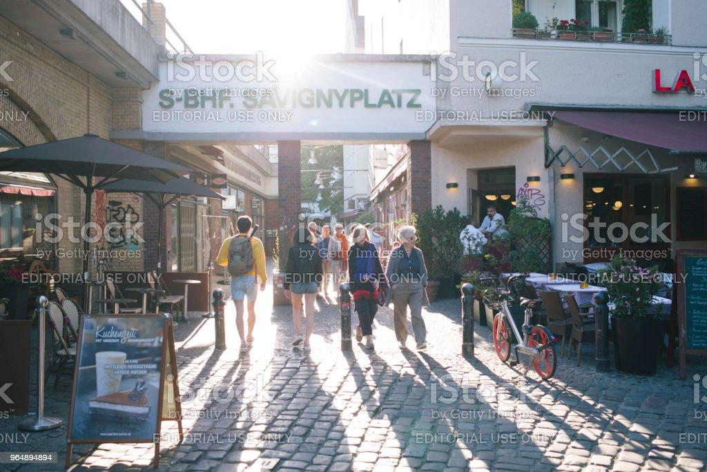 commuter and tourists walk to the subway station 'Savignyplatz'. royalty-free stock photo