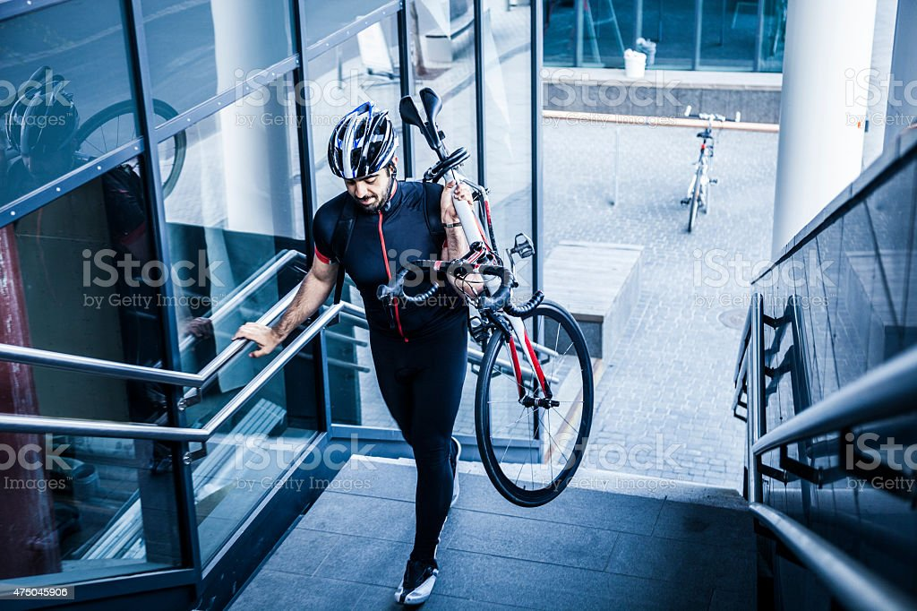 Commuter climbing stairs outside the office stock photo