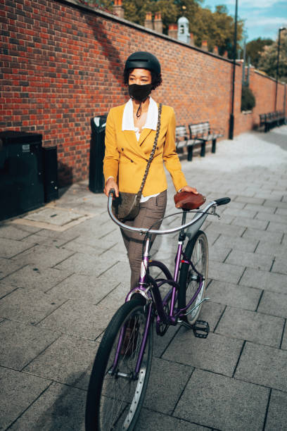 commuter in uk with face mask stock photo