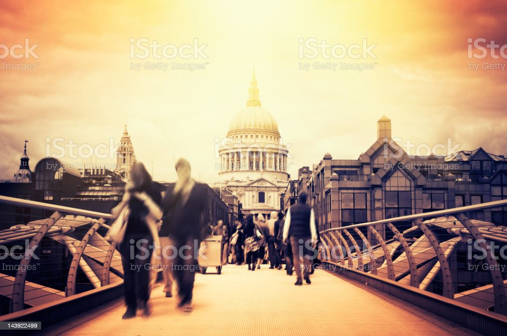 Commuter on the bridge for St Paul's Cathedral in London stock photo
