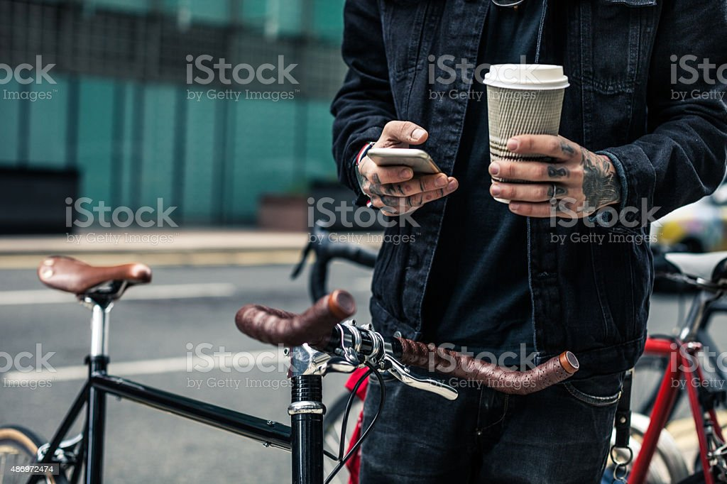 Commuter parking his bicycle outside the office stock photo