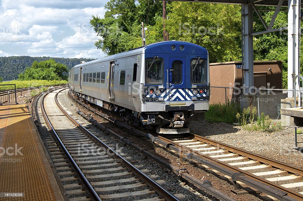 Commuter railroad train passing station, Bronx, New York City stock photo