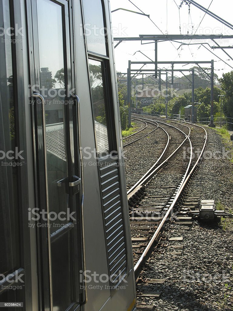 Commuter train and track, vertical royalty-free stock photo