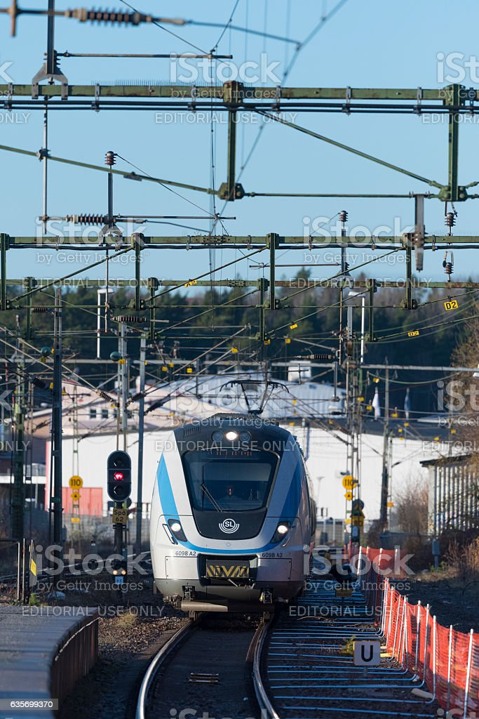 Commuter train approaching the station at Spanga, Stockholm in Sweden royalty-free stock photo