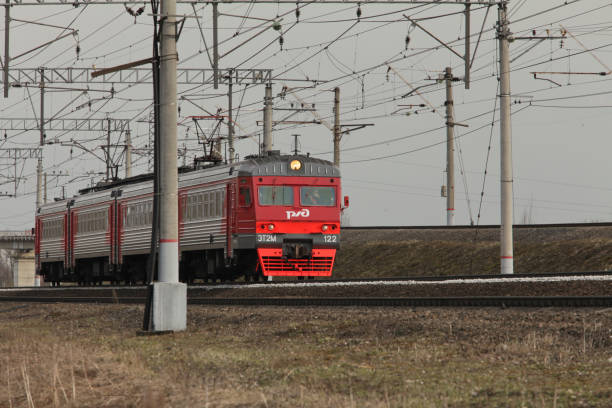 Commuter train countryside April 28, 2017 St. Petersburg, Russian Railways Commuter train countryside electric train stock pictures, royalty-free photos & images