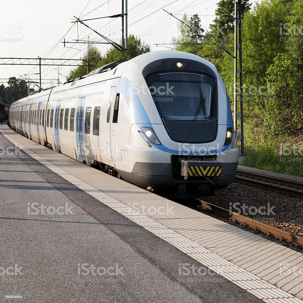 Commuter Train Entering Station stock photo