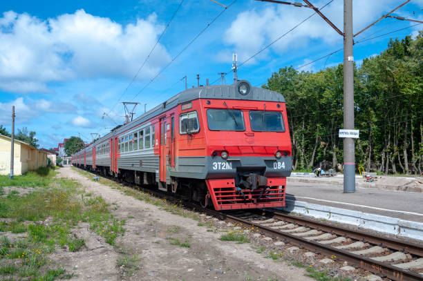 Commuter train ET2M-084 at the station Zelenogradsk of the Kaliningrad railway Zelenogradsk, Kaliningrad region / Russian Federation - July 13, 2017. This model of train was produced in Torchok, Tver Region in 1999-2010. electric train stock pictures, royalty-free photos & images