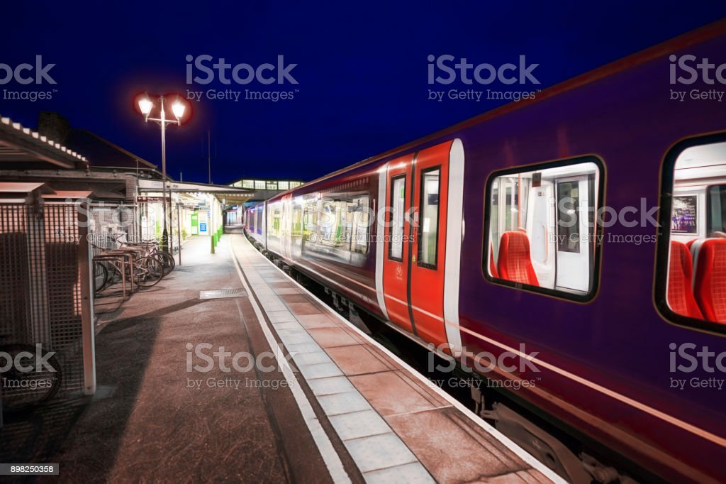 Commuter train in a UK railway station stock photo