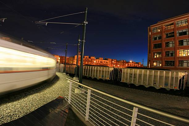 Commuter Train in Downtown Denver At Night stock photo