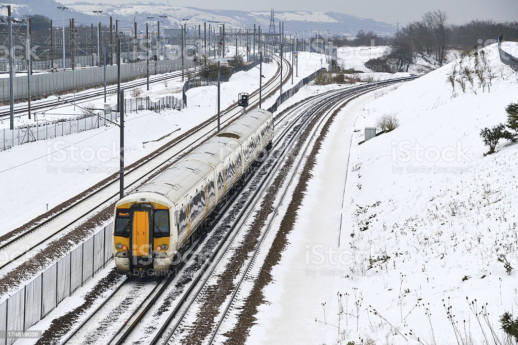 Commuter train in the snow royalty-free stock photo