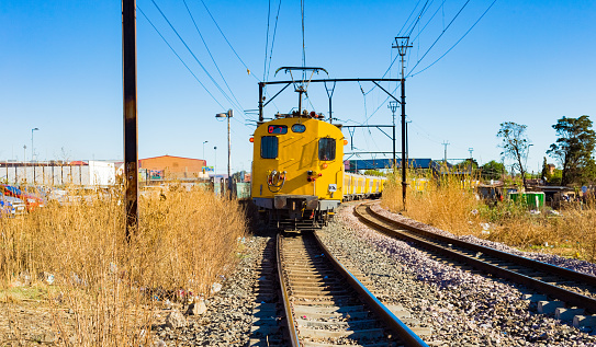 Soweto, South Africa - September 08 2018: Commuter Train moving through the heart of Soweto, Johannesburg