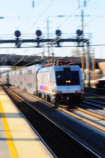 A commuter train speeding through a station.