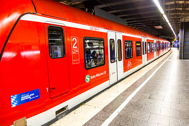 commuter train waits at the munich railway station karlsplatz - munich train station bildbanksfoton och bilder