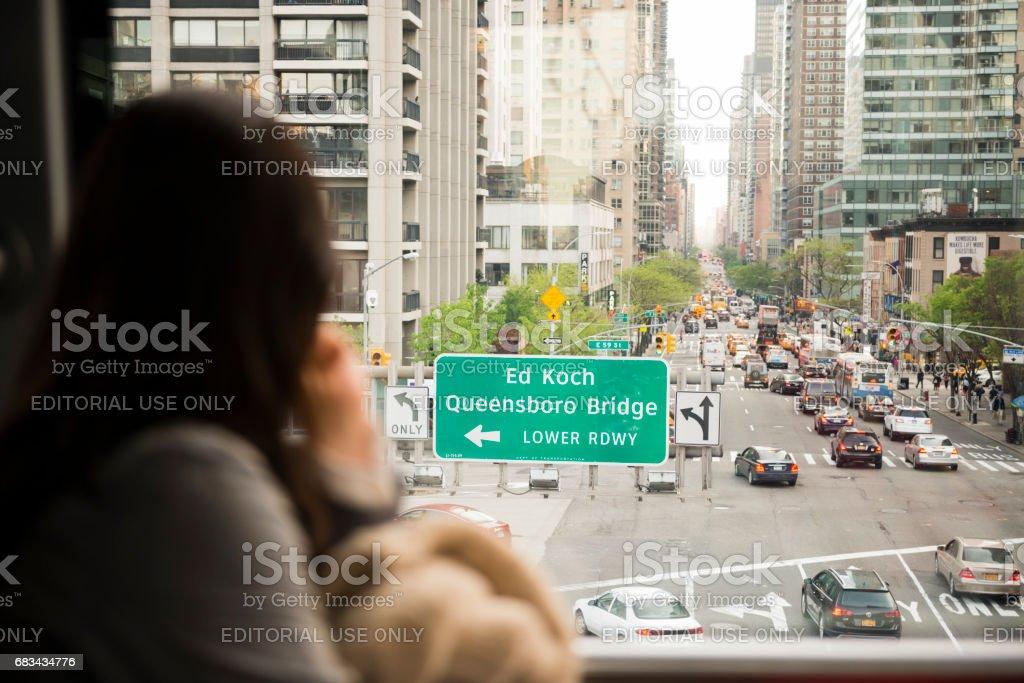 Commuter Tram Passenger Looks at Street View NYC  USA stock photo