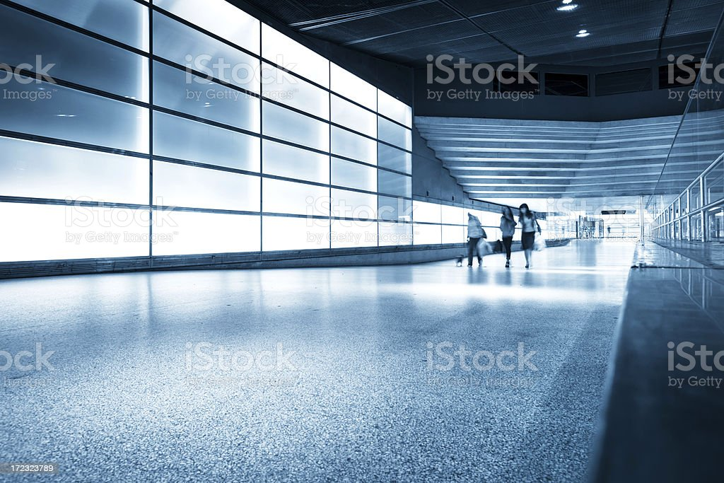 commuter walking in modern architecture royalty-free stock photo