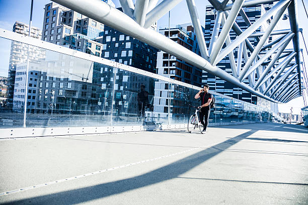 Commuter walking on a bridge in the morning stock photo