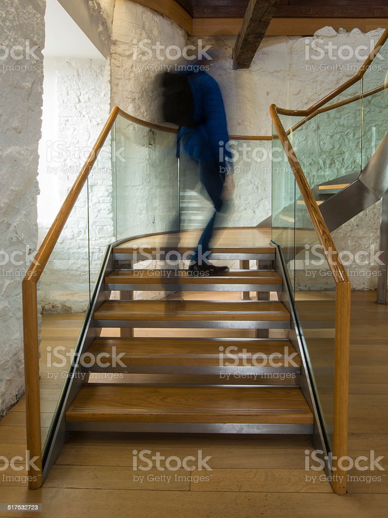 Commuter Walking Up Stairs stock photo