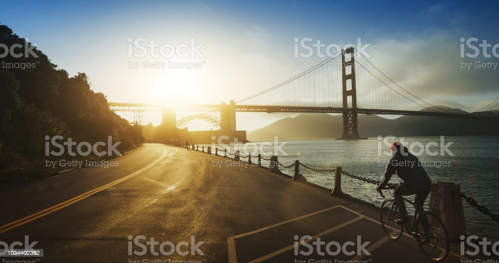 Commuter with road racing bicycle and Golden Gate Bridge stock photo