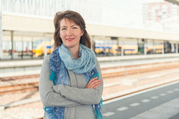 Commuter woman portrait at the station stock photo