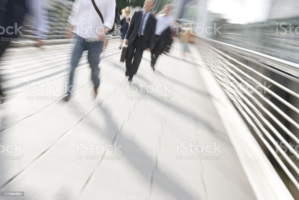 Commuter Zoom on Pedestrian Bridge London stock photo