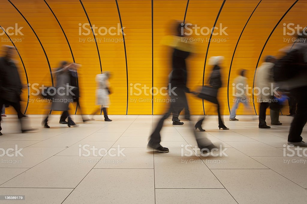 commuters against modern orange background royalty-free stock photo