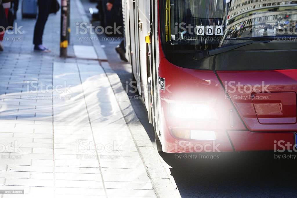 Commuters and red bus stock photo