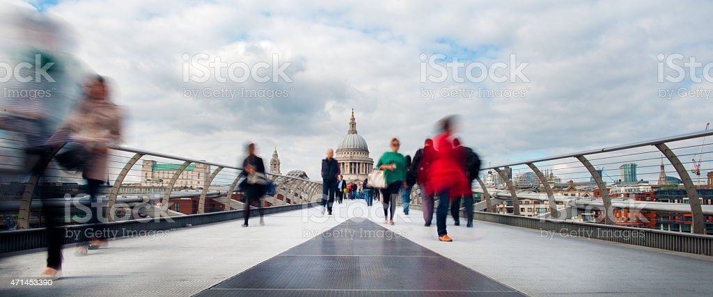 Commuters and Tourists on Millennium Bridge. St Pauls in Rear stock photo