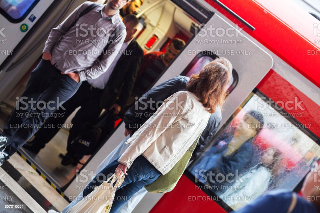 Commuters at S-Bahn train stock photo